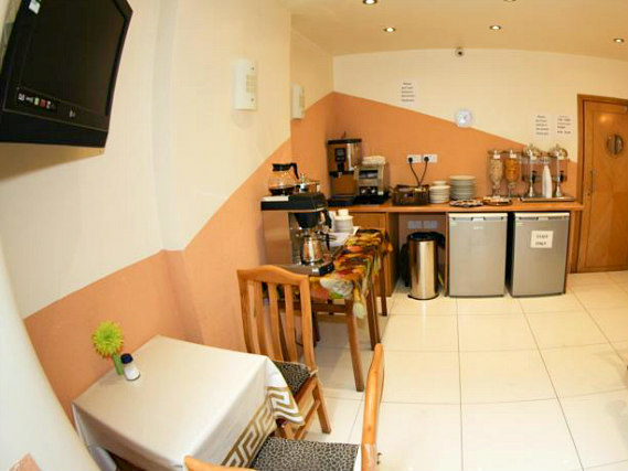 Save even more money by preparing your own food in the self-catering kitchen at Kensington Suite Hotel