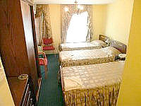 A triple room at the Exhibition Court Hotel 4