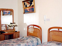A typical twin room at Exhibition Court Hotel 4