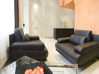 Relax in the Reception Room on its comfy leather chairs