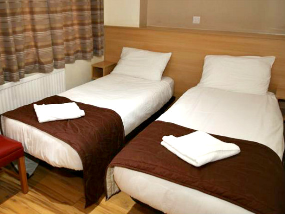 A spacious twin room at Holland Court Hotel