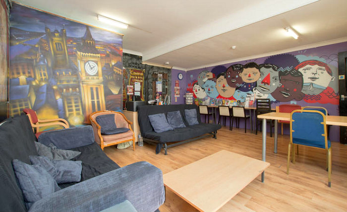 Make new friends and chill out in the TV lounge at the Central Hostel