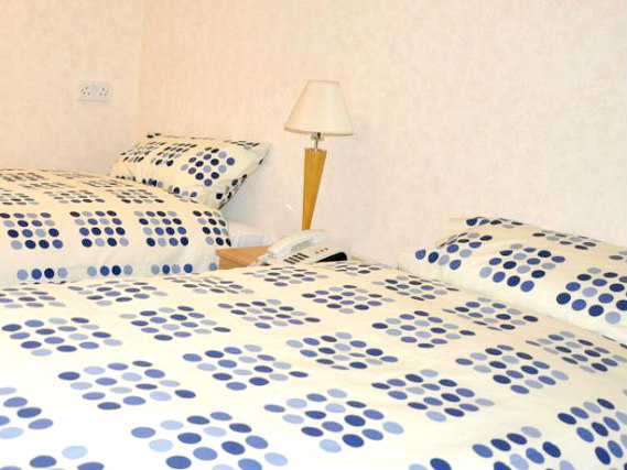 A typical twin room at Heathrow Lodge