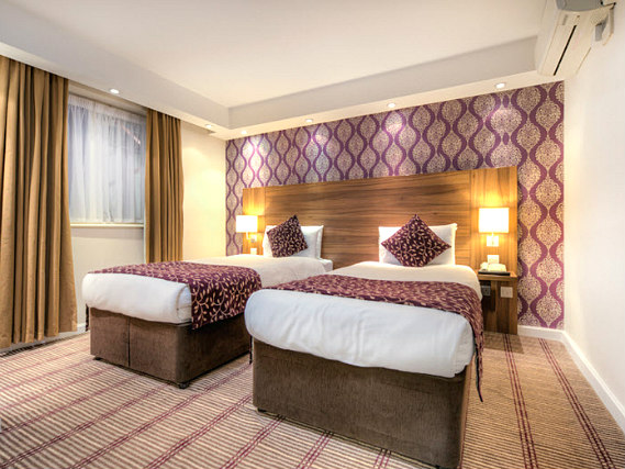 A twin room at City Continental London Kensington is perfect for two guests
