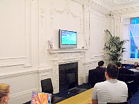Sky TV and comfy surroundings in the television Lounge at Hyde Park Hostel