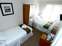 A triple room at Lexham Gardens Hotel
