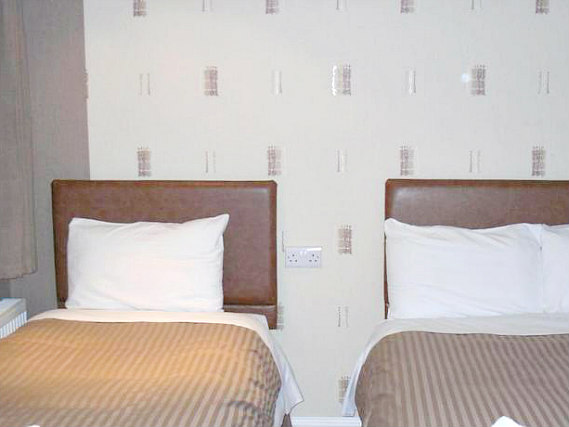 A typical triple room at Linden House Hotel