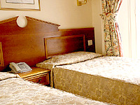A Twin room at Pembridge Palace Hotel London