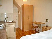 A typically simple and stylish Double room at Earls Court Studios