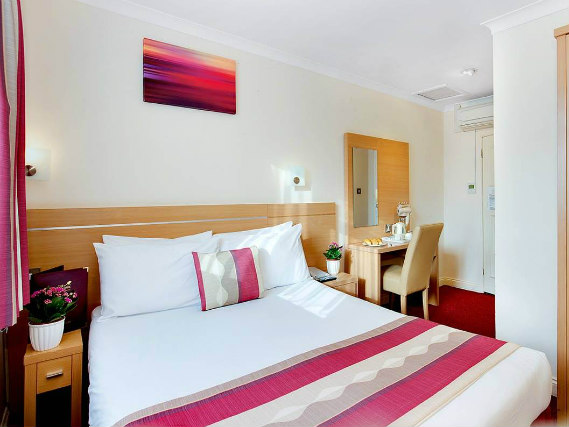 Get a good night's sleep in your comfortable room at Queens Park Hotel