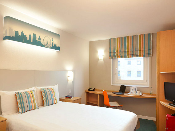 Get a good night's sleep in your comfortable room at Custom House Hotel