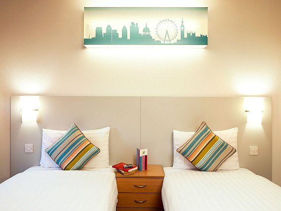 A twin room at Custom House Hotel is perfect for two guests