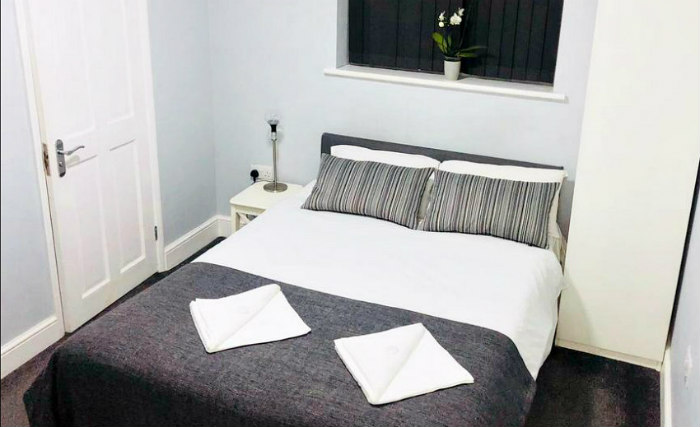 Rest easy in a comfortable bed in your room at Manor House London
