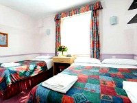 A typical triple room at Marble Arch Inn