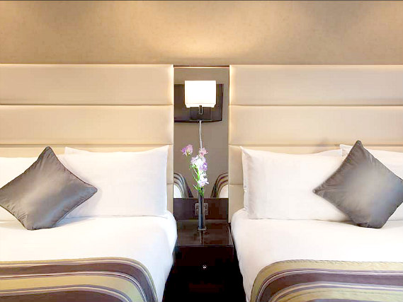 A twin room at Shaftesbury Premier London Hyde Park Hotel is perfect for two guests