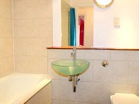 Bathrooms are stylish and modern at Access Apartments City