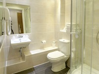 A typical bathroom at Ambassadors Hotel London Kensington
