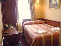 A typical double bedroom at the Avon Hotel London