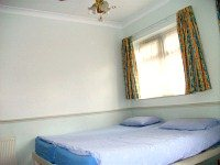 A typical simply furnished double ensuite room