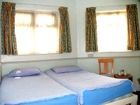 A typical simply furnished twin ensuite room