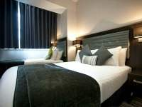 A typical triple room at The W14 Hotel London
