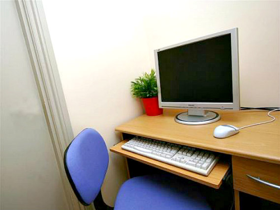 Most rooms have desks at the All Star Hostel London