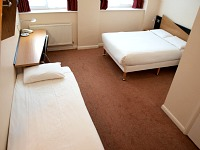 A triple Budget room at Vauxhall Hotel
