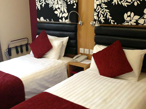 A twin room at Astors Hotel is perfect for two guests