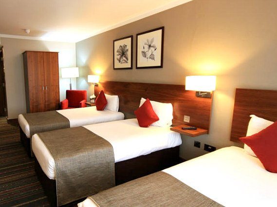 Rest easy in a comfortable bed in your room at Best Western Palm Hotel London