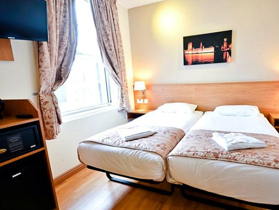 A twin room at Kings Cross Inn Hotel is perfect for two guests