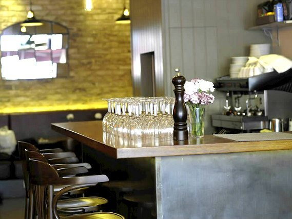 After a busy day, relax with a drink in the bar at Kings Cross Inn Hotel