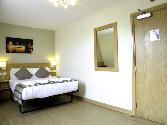 Get a good night's sleep in your comfortable room at Kings Cross Inn Hotel
