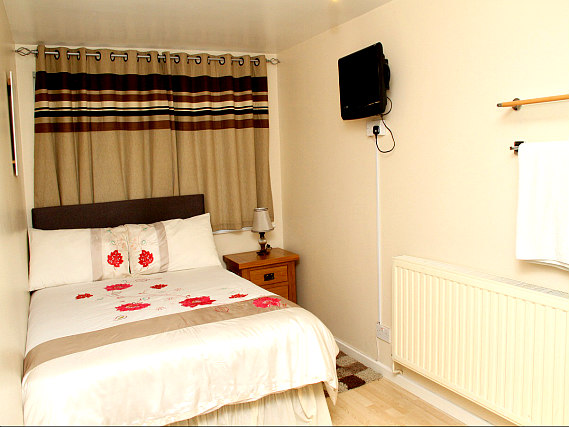 Put your feet up in front of the TV in your room at Julius Lodge Thamesmead