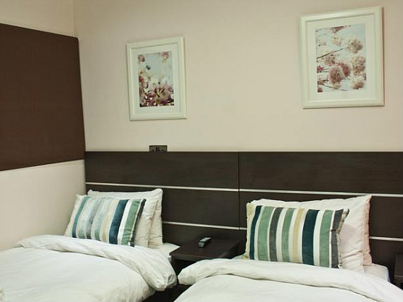 A twin room at BayTree Hotel is perfect for two guests