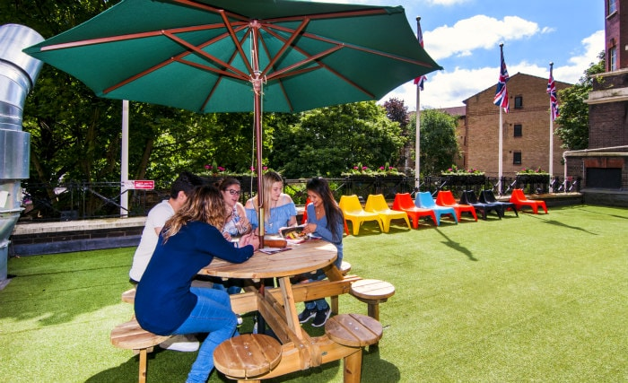 Relax with friends in the private gardens at Rest Up London