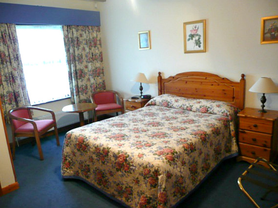 Get a good night's sleep in your comfortable room at Cottage Guest House