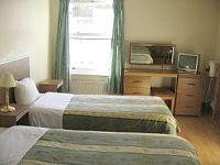 A twin room at Carlton Hotel London