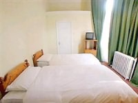 A Triple room at Chelsea House Hotel