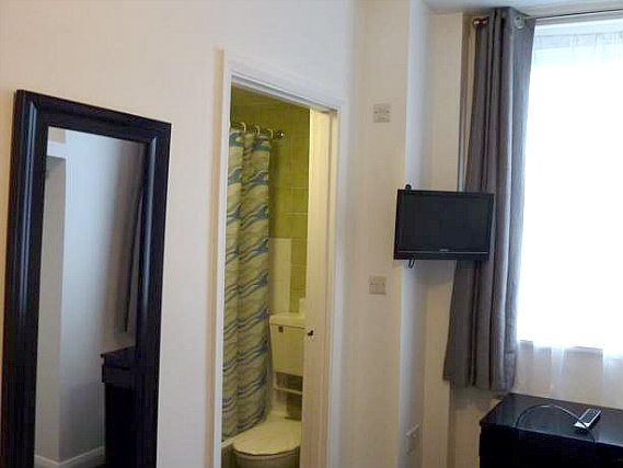 Relax in the private bathroom in your room at Notting Hill Hotel