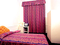 A typical Double room at Palace Court Hotel London
