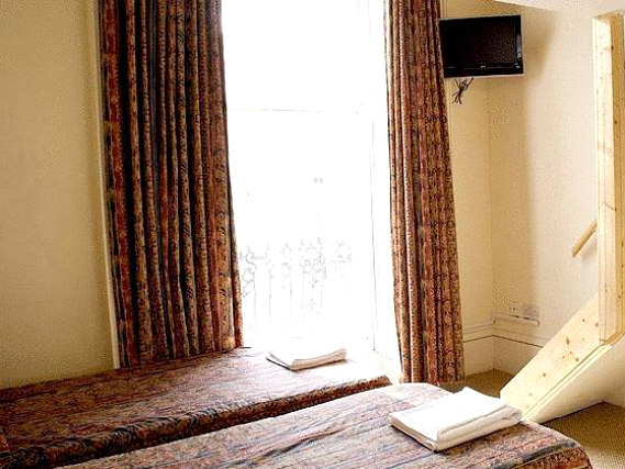 A twin room at Palace Court Hotel London is perfect for two guests