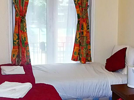 A twin room at Victoria Station Hotel is perfect for two guests