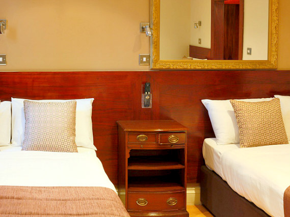 Quad rooms at Garden View Hotel are the ideal choice for groups of friends or families