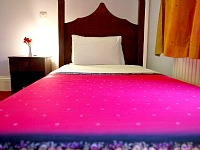 A bedroom for the pink lovers at Islington Inn