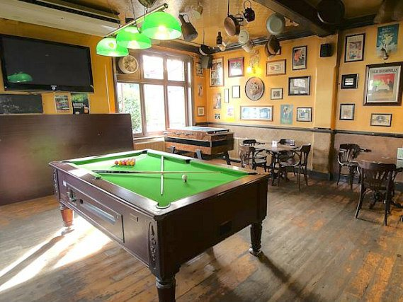 Join the locals with a game of pool