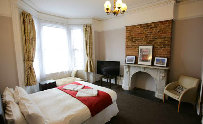 Get a good night's sleep in your comfortable room at Manor House London