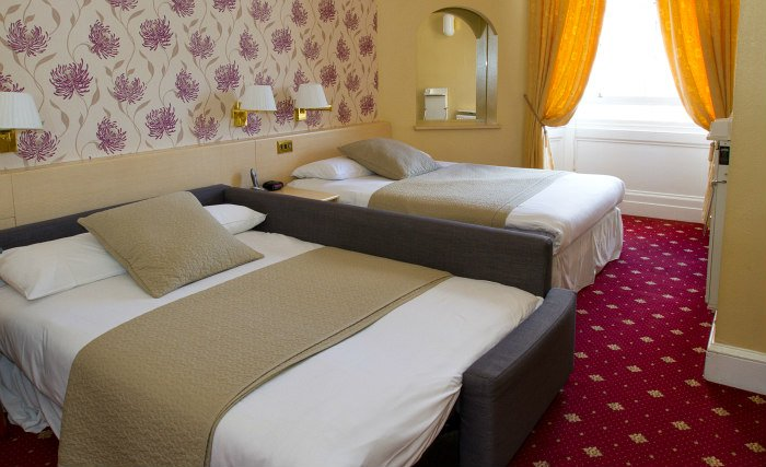 Quad rooms at Manor House London are the ideal choice for groups of friends or families