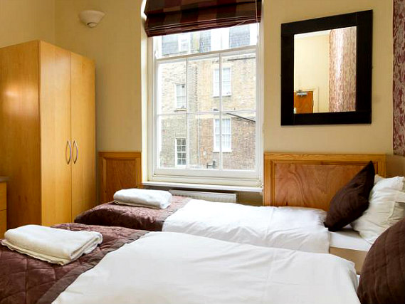 A twin room at Excelsior Hotel is perfect for two guests