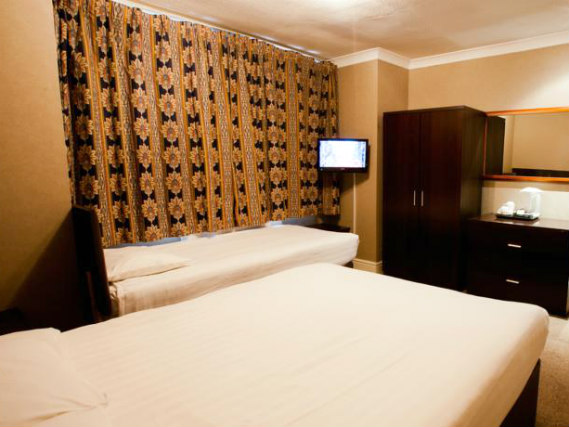 A twin room at Rossmore Hotel