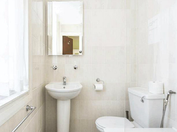 Relax in the private bathroom in your room at The Ridgeway Hotel